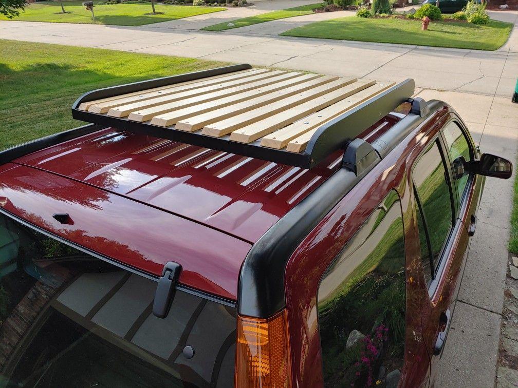 Diy wood roof rack in 2020 roof rack wood roof luggage