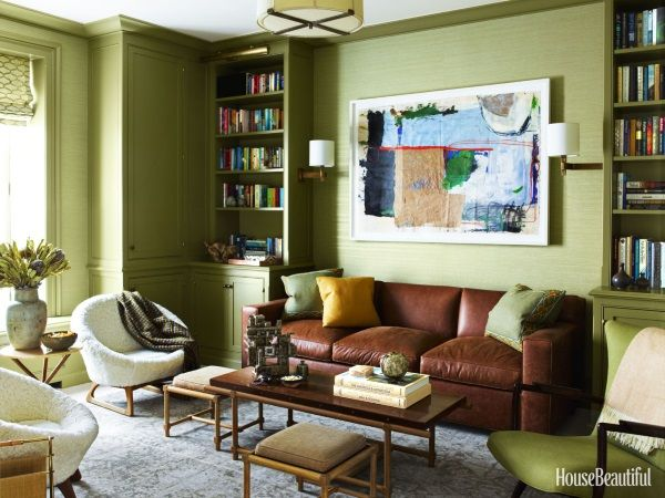 A Grey Blue Oushak Rug Compliments Olive Green Walls And Upholstery And A Brown Leather Sofa Adds Warmth And T Living Room Color Family Room Design Room Colors