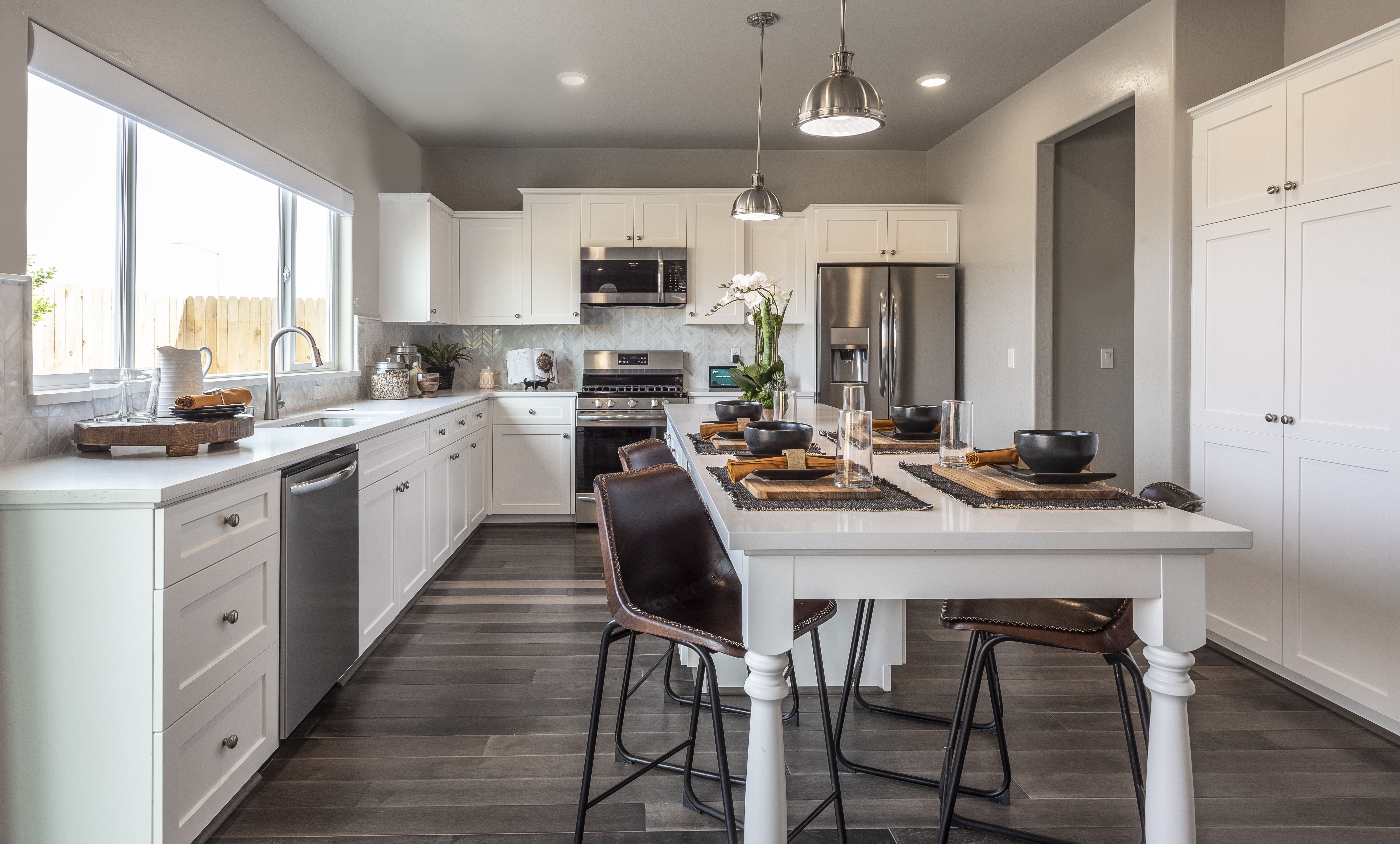 White Kitchen Cabinets With Quartz Counter Tops And Herringbone Backsplash Modern Farmhouse Decor With Wood Mu In 2020 New Homes For Sale Open Concept Home New Homes