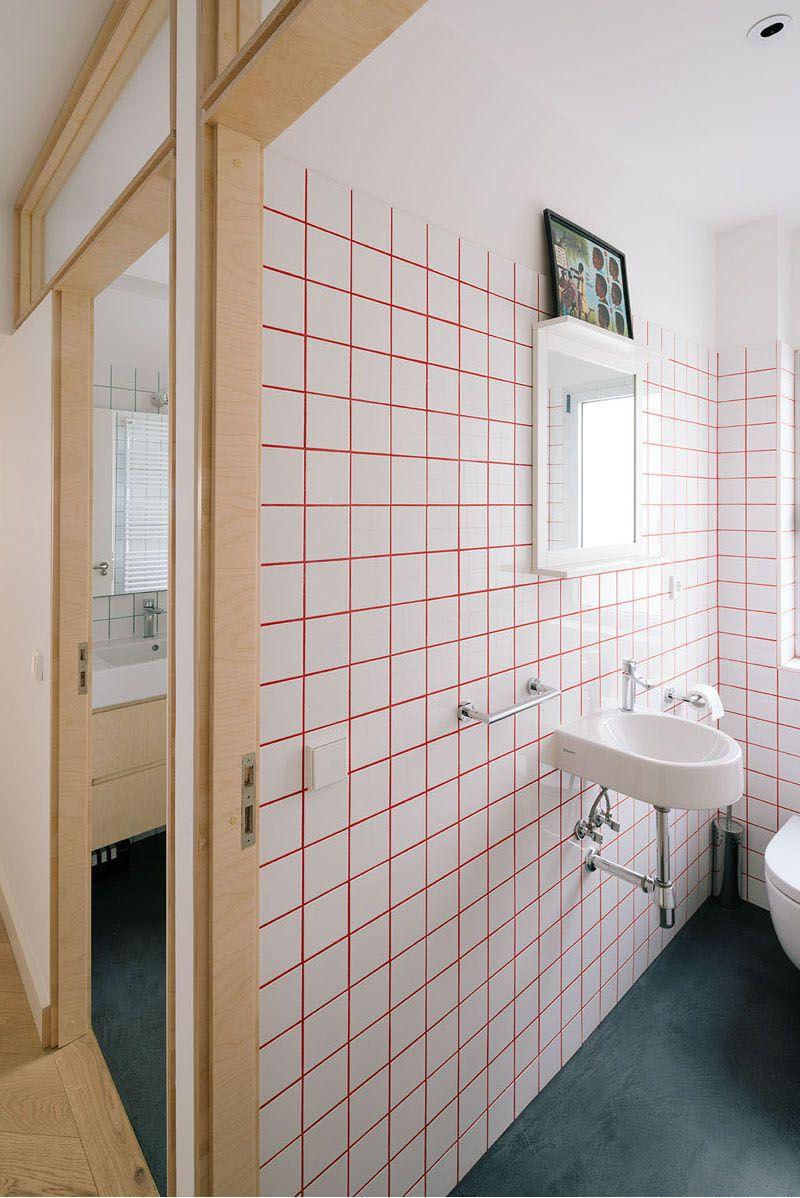 Dit huis laat zien dat gekleurde voegen elke tegelwand tot eye ...