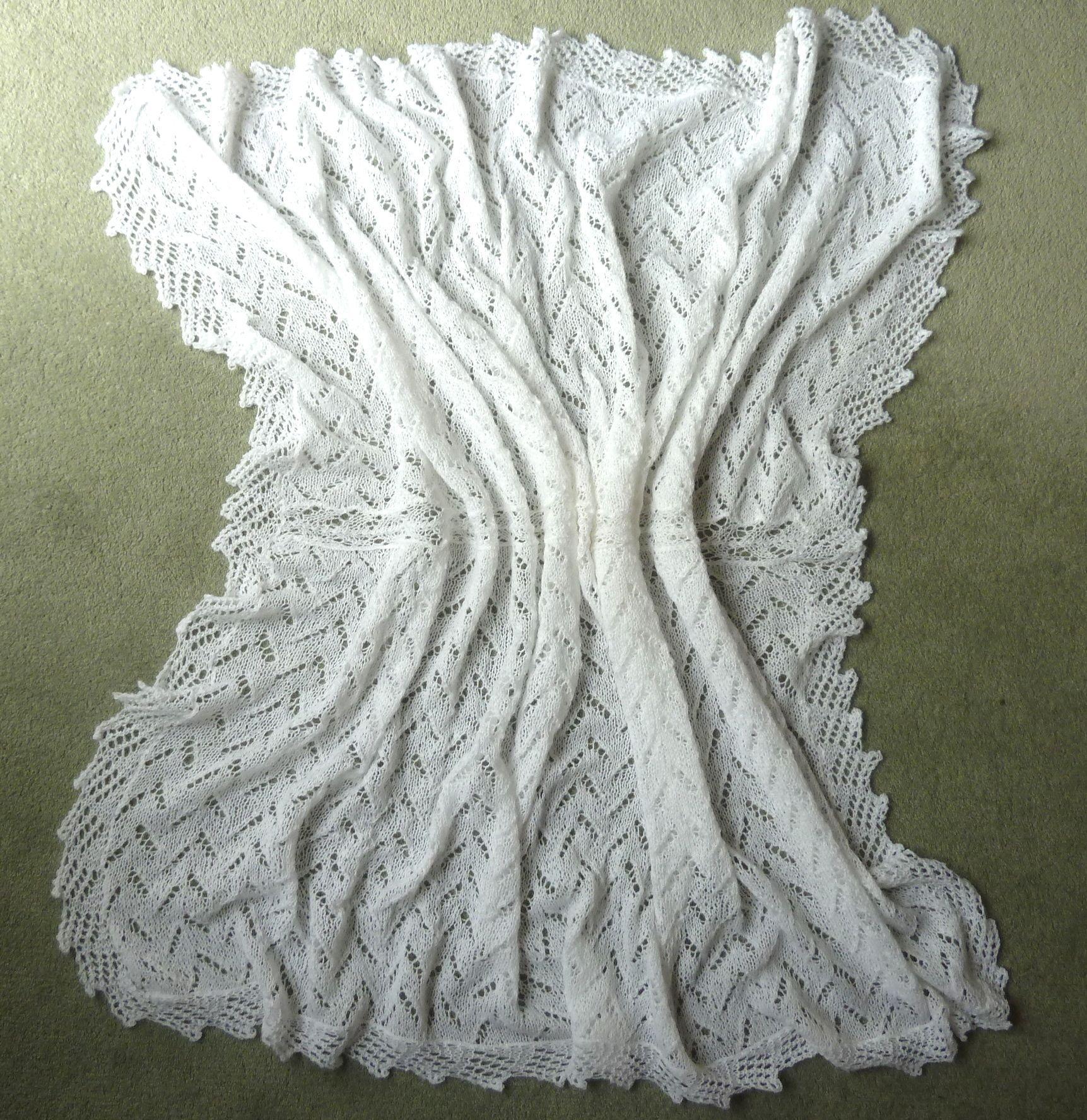 A fine knit baby shawl/blanket