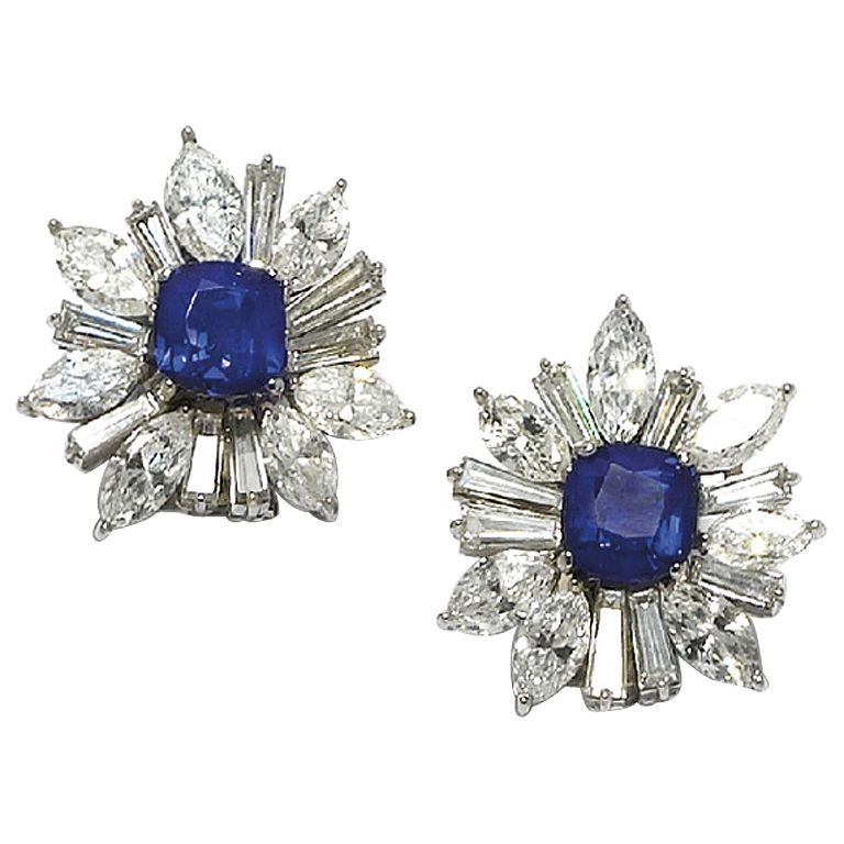 HARRY WINSTON . a pair of sapphire and diamond ear clips, each centering upon a cushion-cut sapphire, weighing 2.87cts and 2.92cts, within a marquise and tapered baguette-cut diamond surround, mounted in platinum. Circa 1980s