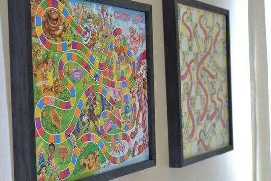 Hang board games in glassless frame with pieces in back then just take down and play :)