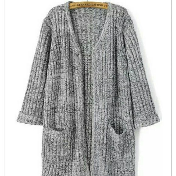 • AVAILABLE AFTER Jan 12th, 2016 • Grey cardigan! Very heavy and thick material❄ It comes sewn together, but if you want it to partition, like the first picture, you can alter it. Fits like a large, it's oversized.  Ships within three days ✔ No Trades ✔ No PayPal  Nonsmoking home  Pet-free home Sweaters Cardigans