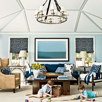 Designer Andrew Howard created a durable beach-house family room. The side tables and chairs are from Noir; the curtain fabric is by Kravet. Photo: Erica George Dines.
