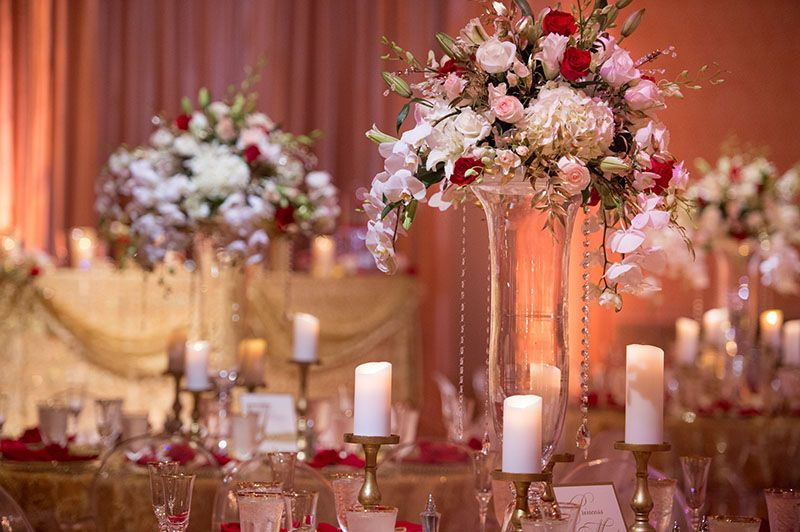 Floral Centerpieces With Candle Accents At This Reception Wedding