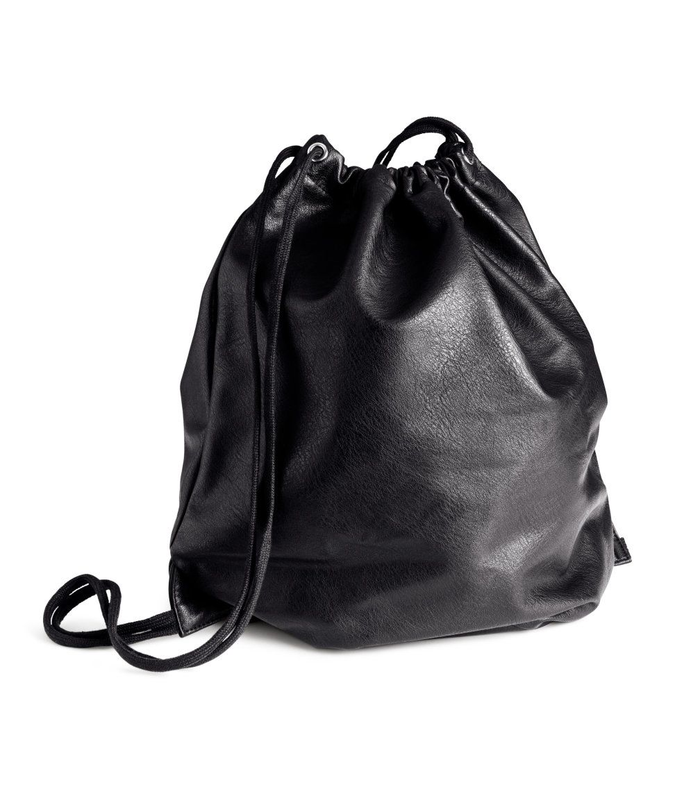 210cc3a468c4 Black faux-leather drawstring backpack.
