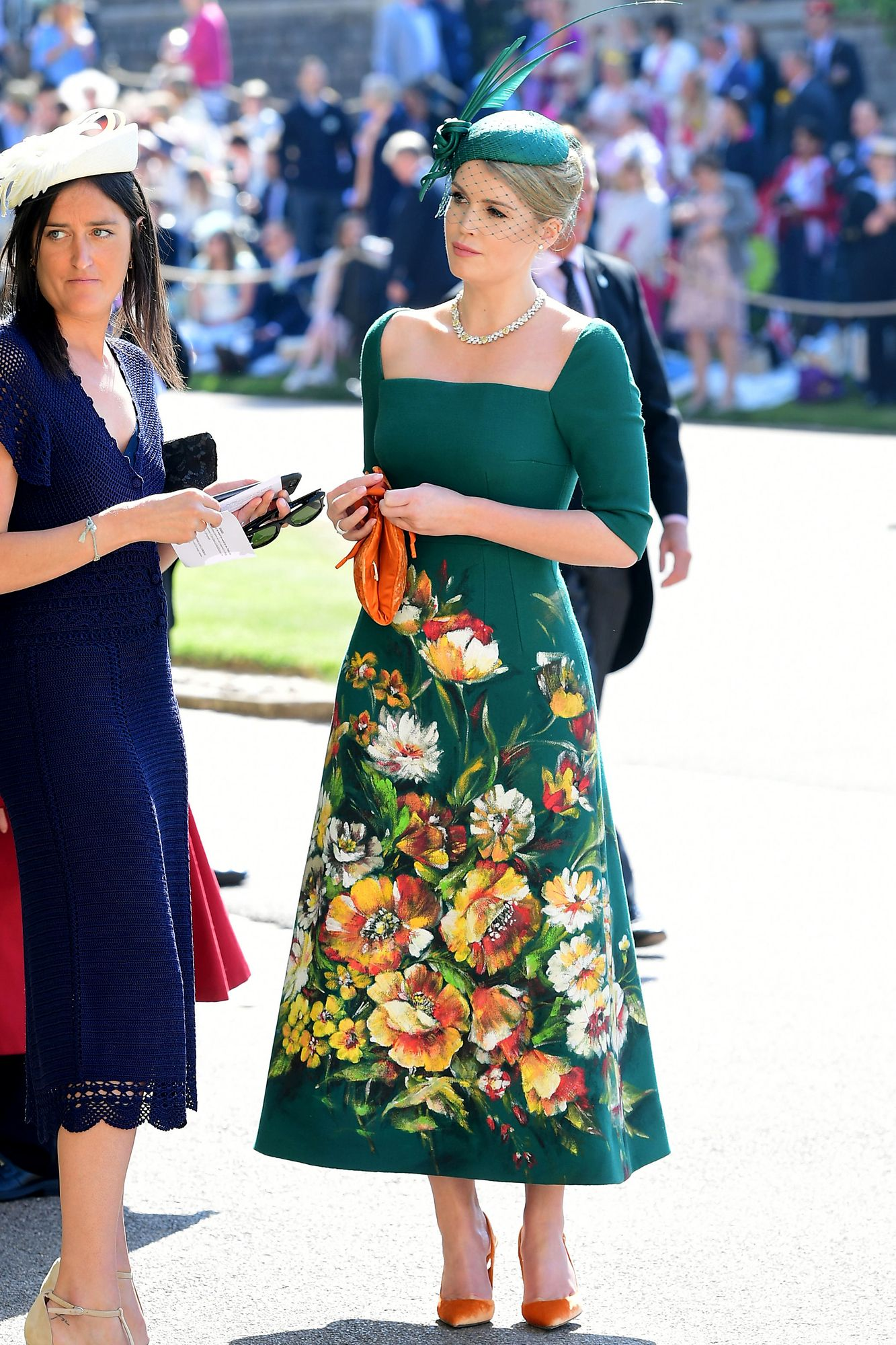 The royal cousin wears a square-neck floral print emerald-green dress with  Bulgari jewelry and orange pumps. Shop the look  Manolo Blahnik pumps 4f4293ebbce3