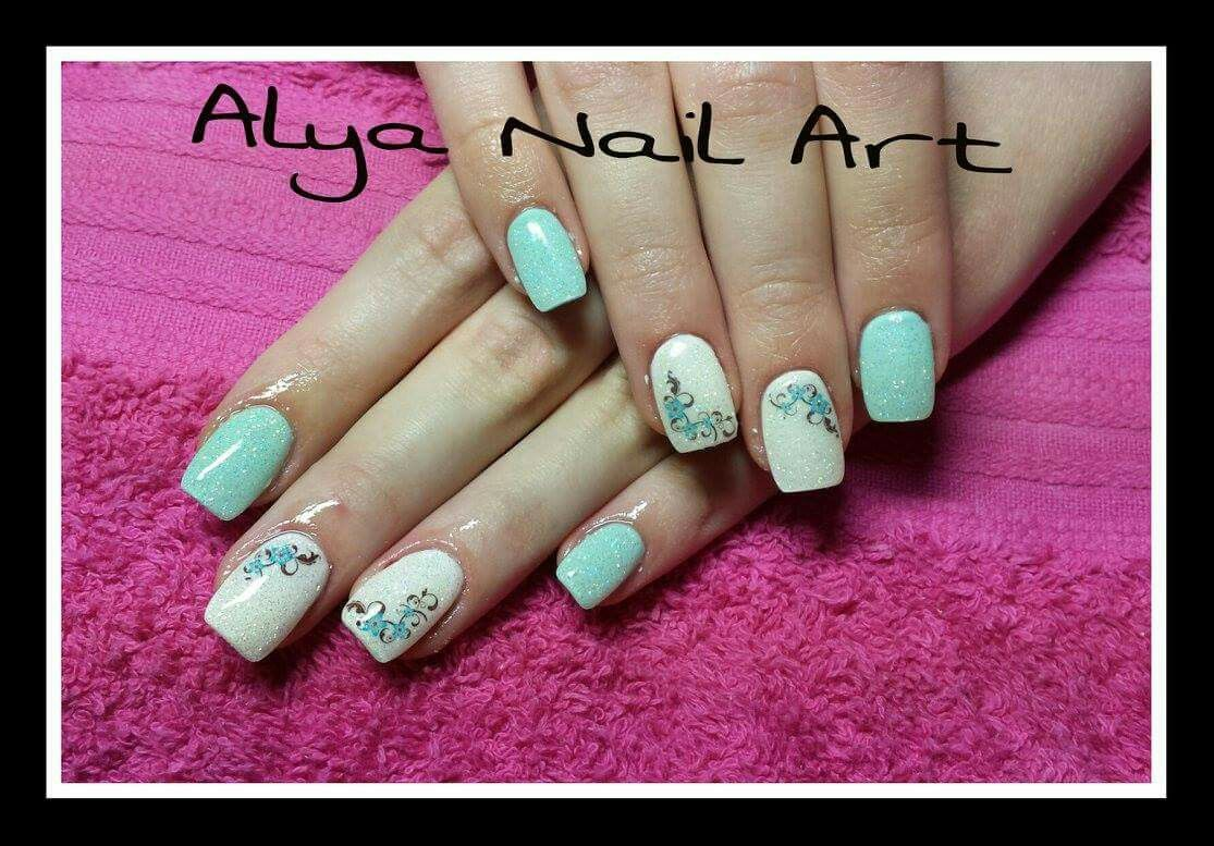 Turquoise gel nails with flowers and glitter