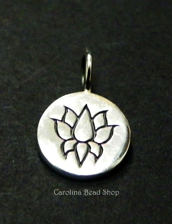 Sterling Silver Lotus Charm. Round Tag with Lotus Flower Stamp. Length measure includes 4mm soldered loop.    Cast in Thailand.    Size (mm): 12