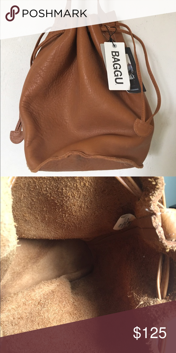 Perfect Crossbody Bucket Bag The perfect every day crossbody bucket bag! Looks amazing with any outfit! Never used and new with tags. The strap is about 26 inch, and the bag is about 6 inch in length and width. In addition, the height is about 9.5 inch. Baggu Bags Crossbody Bags