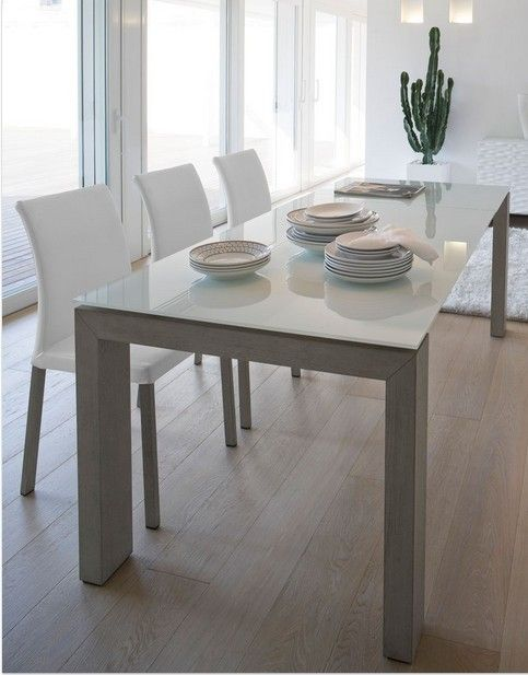 Montreal a extendible table with shining painted glass top for Dining room tables montreal