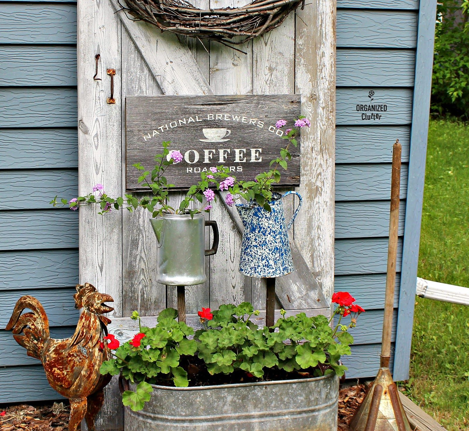 Garden decor out of junk  Coffee Themed Junk Garden Vignette with Barn Door Backdrop