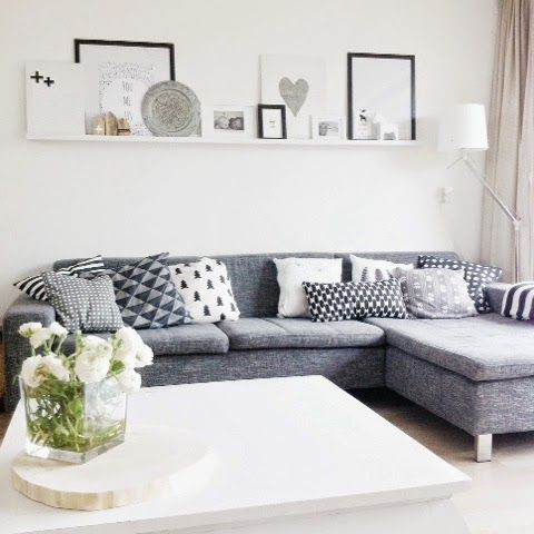 love the narrow shelving above this sofa in this living room, great