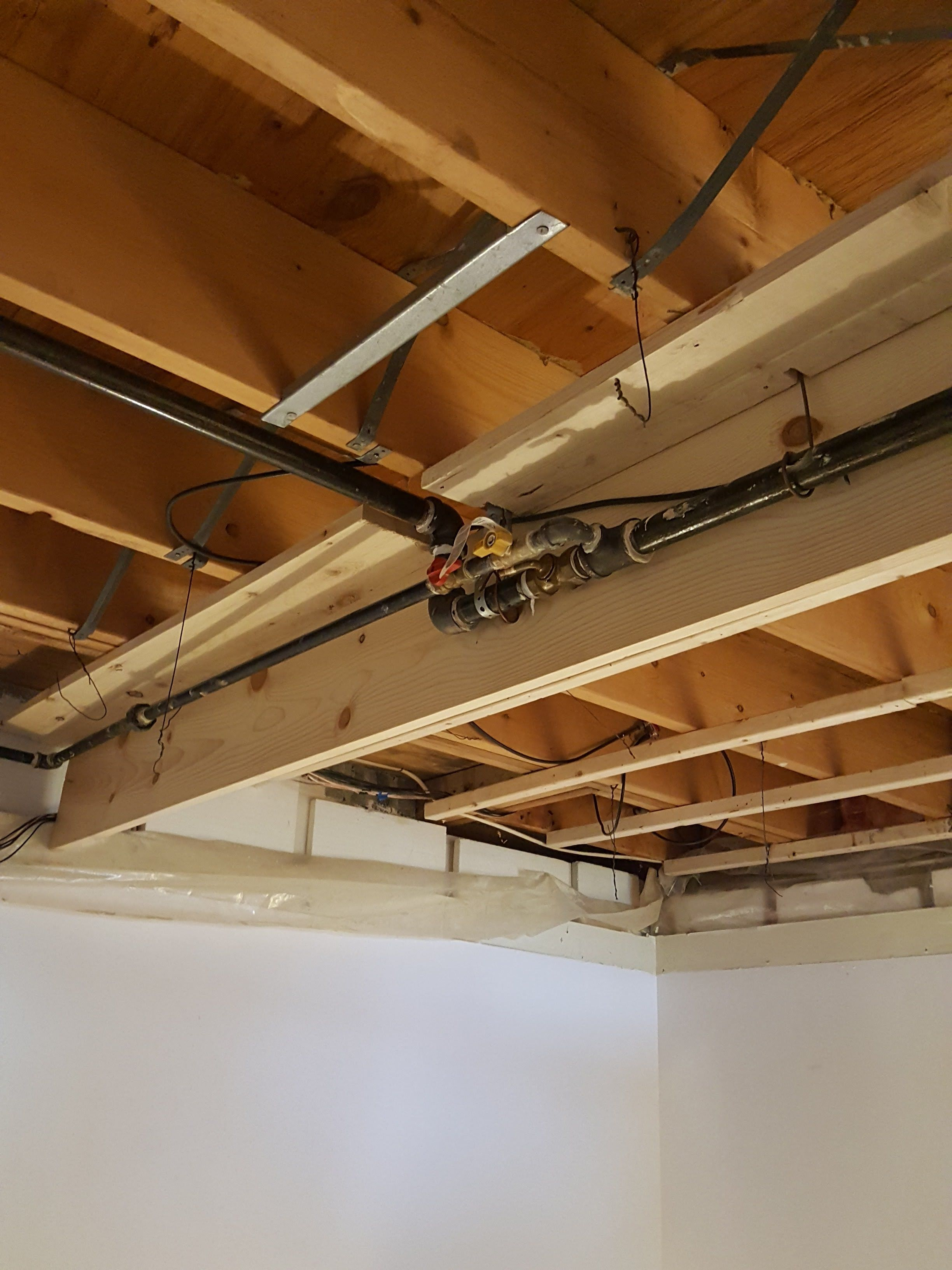 I Decided To Raise The Ceiling Up To The Floor Joists Of The Main Level And Create A Faux Beam For The Gas Line Faux Beams Basement Craft Rooms Beams