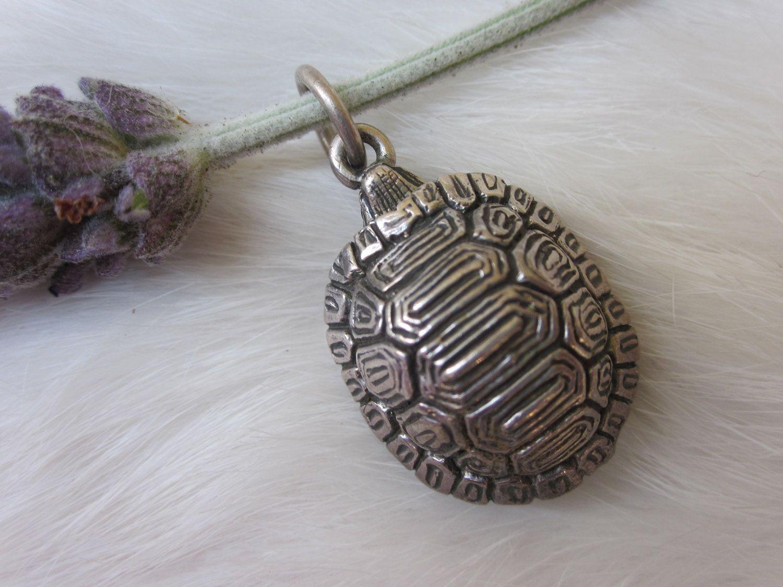 Turtle Tortoise Vintage sterling silver pendant poison charm trinket locket with vintage chain. $45.00, via Etsy.
