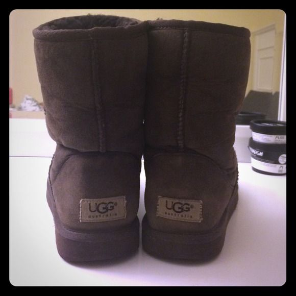 Preloved brown ugg short boots Still in good shape comfy a little worn perfect for winter very comfortable and cute.. Has small stains shown in picture... Very little water damage on toes of shoe UGG Shoes