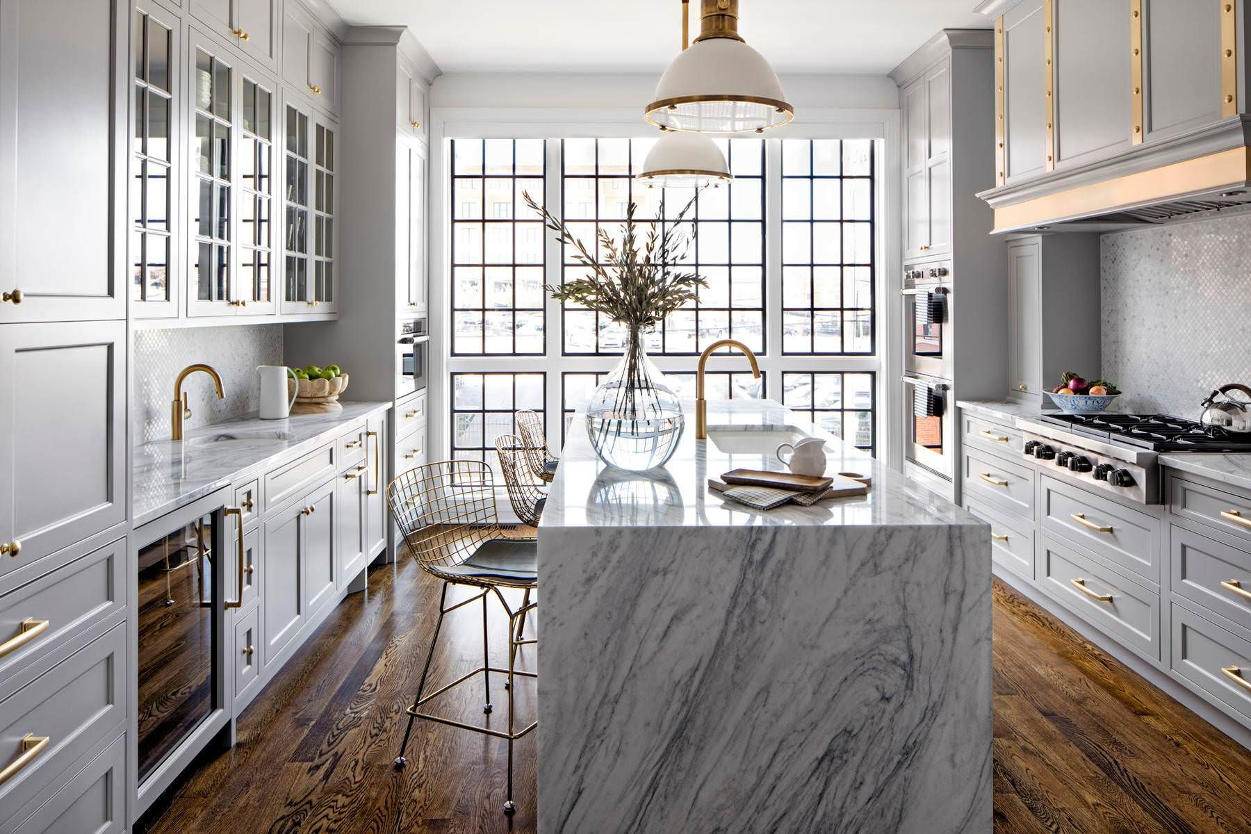 Kitchen Features A Waterfall Marble Island And Large Metal Framed