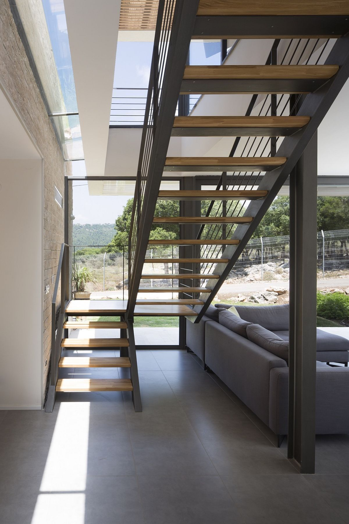 Metallic staircase gives the interior an edgy contemporary