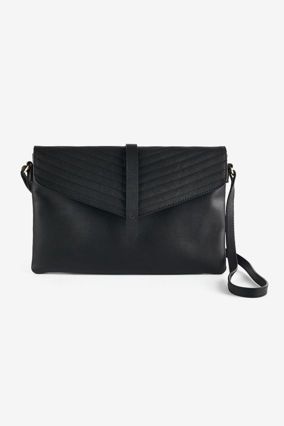 bde01274ef1c This genuine leather crossbody by Noir Luxe features a quilted flap detail  and adjustable strap.