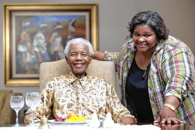 "Nelson Mandela with his personal chef Xoliswa Ndoyiya, who has authored a cookbook called ""Ukutya Kwasekhaya: Tastes From Nelson Mandela's Kitchen"" with Anna Trapido."