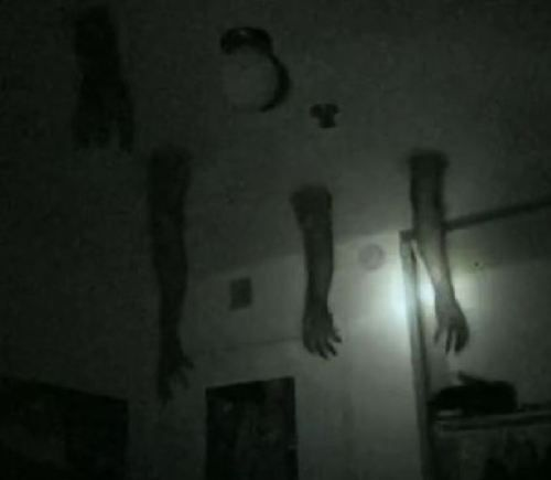 Cool idea for fake arms this would be cool for a for Haunted house hallway ideas