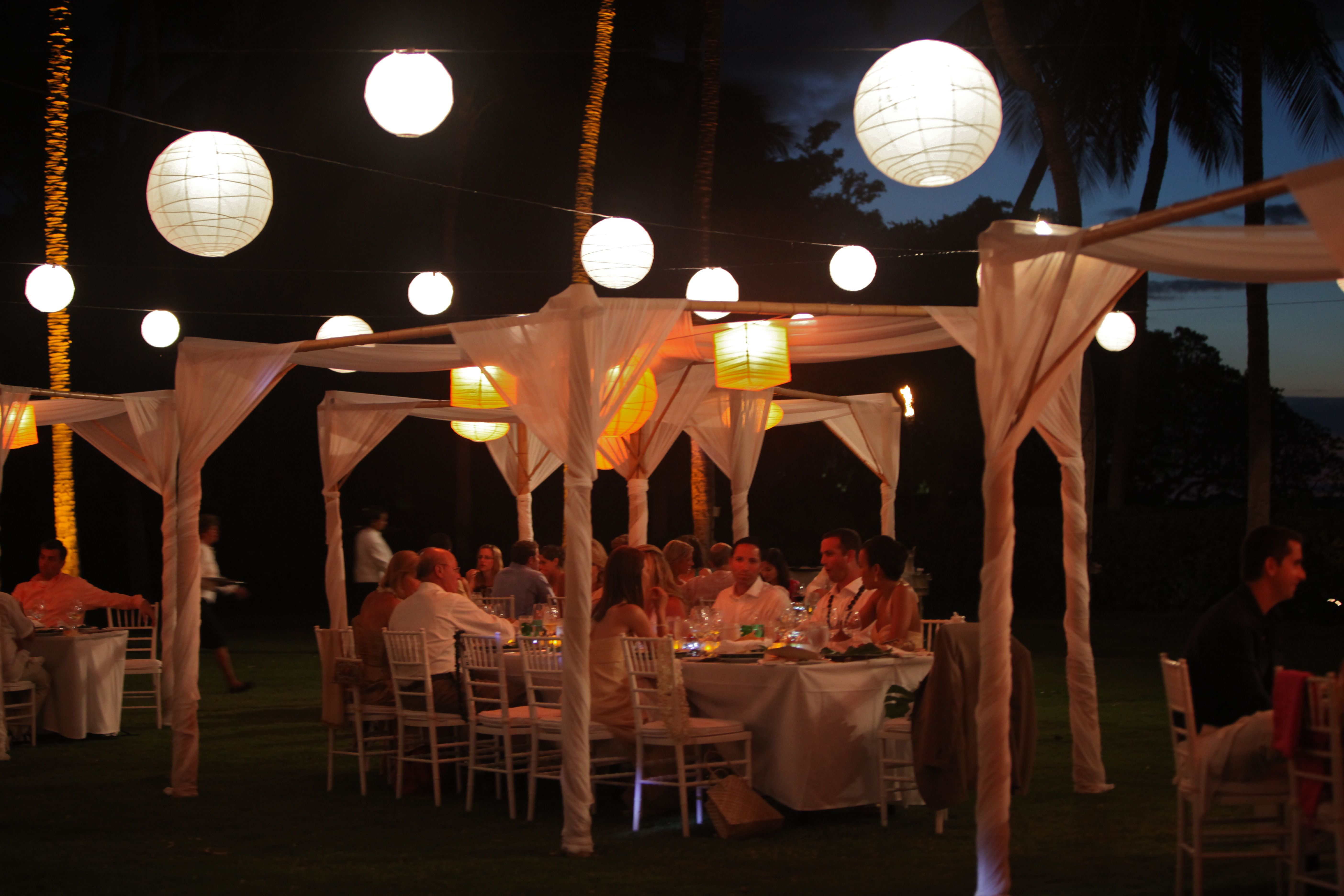 Love these dining tents with lanterns overhead