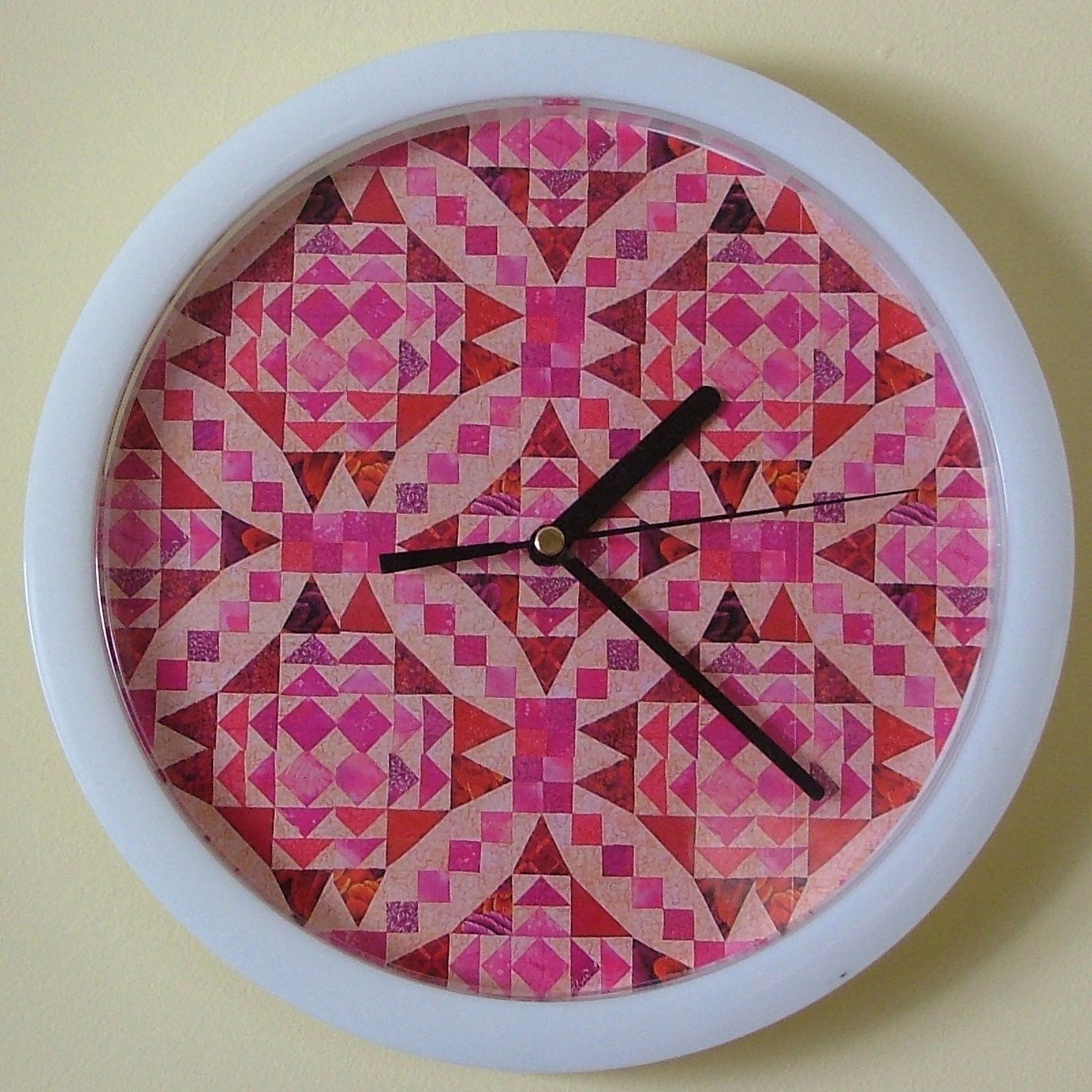 an old clock from Lincraft and some patchy wrapping paper. Perfect for the studio!