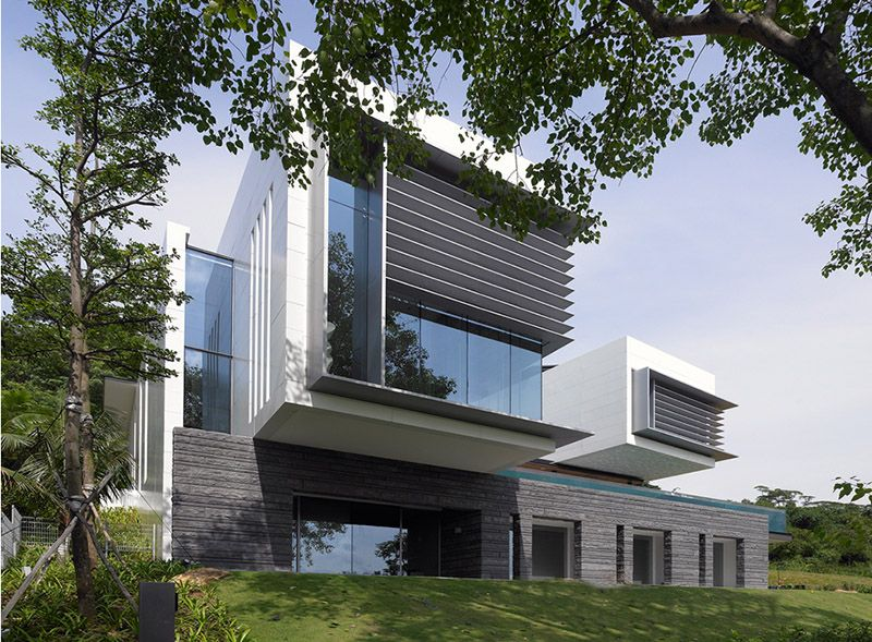 The lakeshore view house by scda architects resides is a modern two story home in sentosa singapore whose big feature is an acrylic suspended swimming pool
