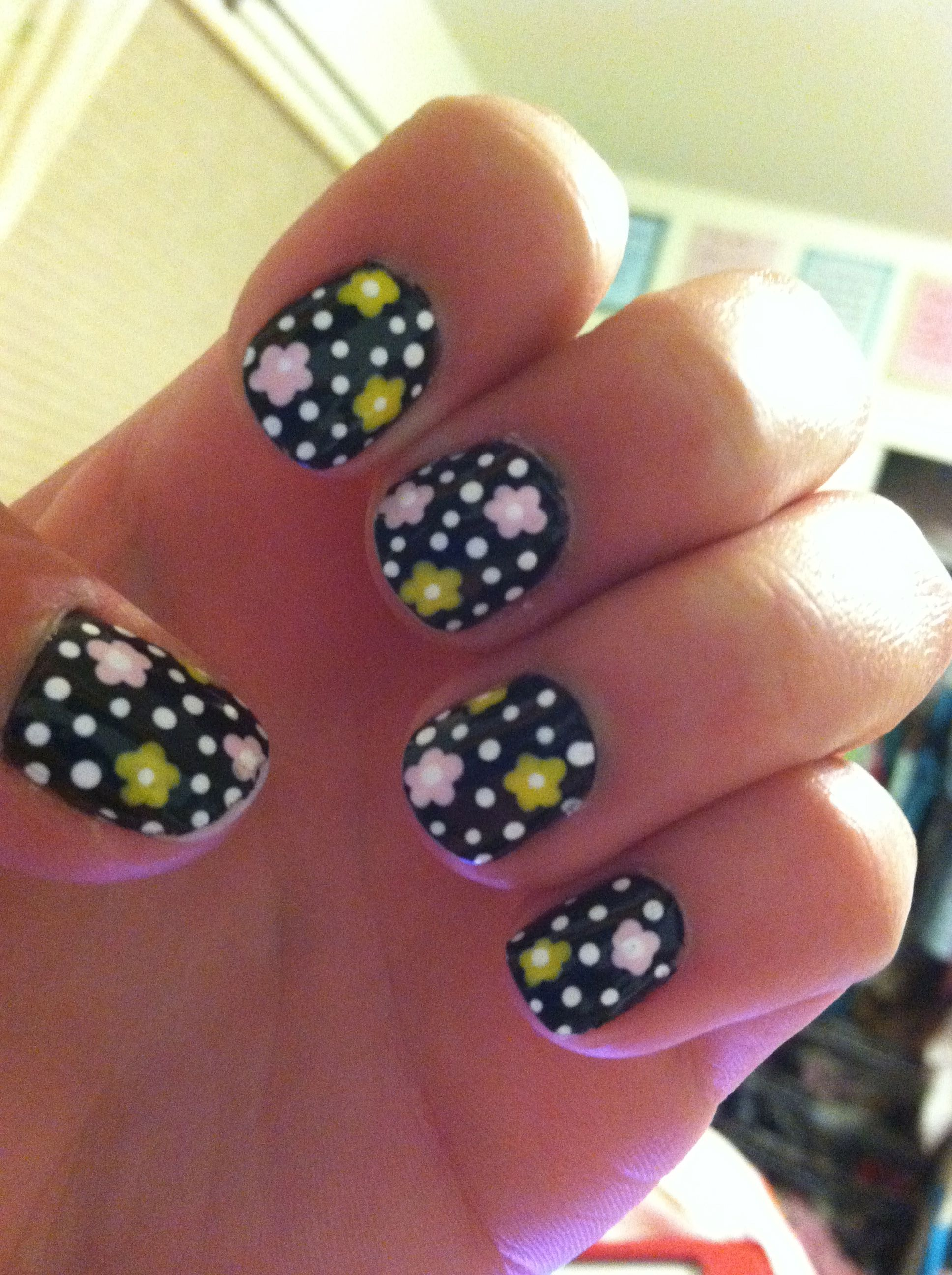 Black Nails With Pink And Yellow Flowers And White Dots Nail Art Dot Nail Art Dots Nails Nail Art