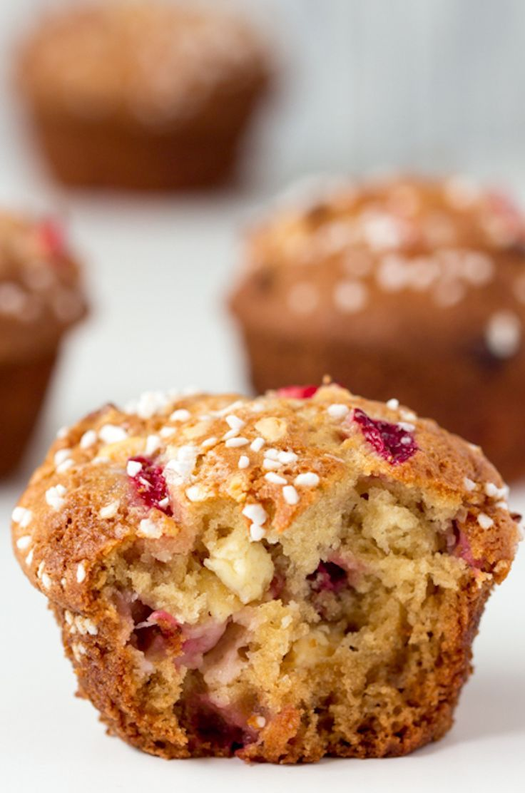 Bakery Style Strawberry and White Chocolate Muffins - fluffy and sweet with a delicious strawberry tang.   Ideahacks.com