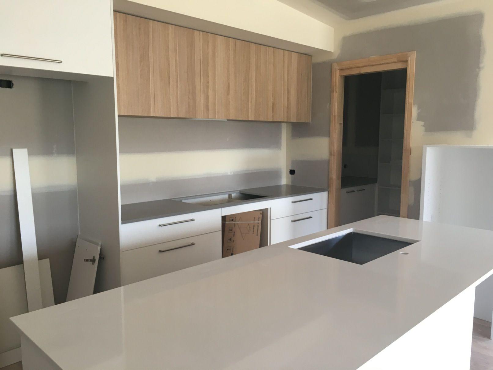Polytec natural oak revine cabinets with white + concrete look stone