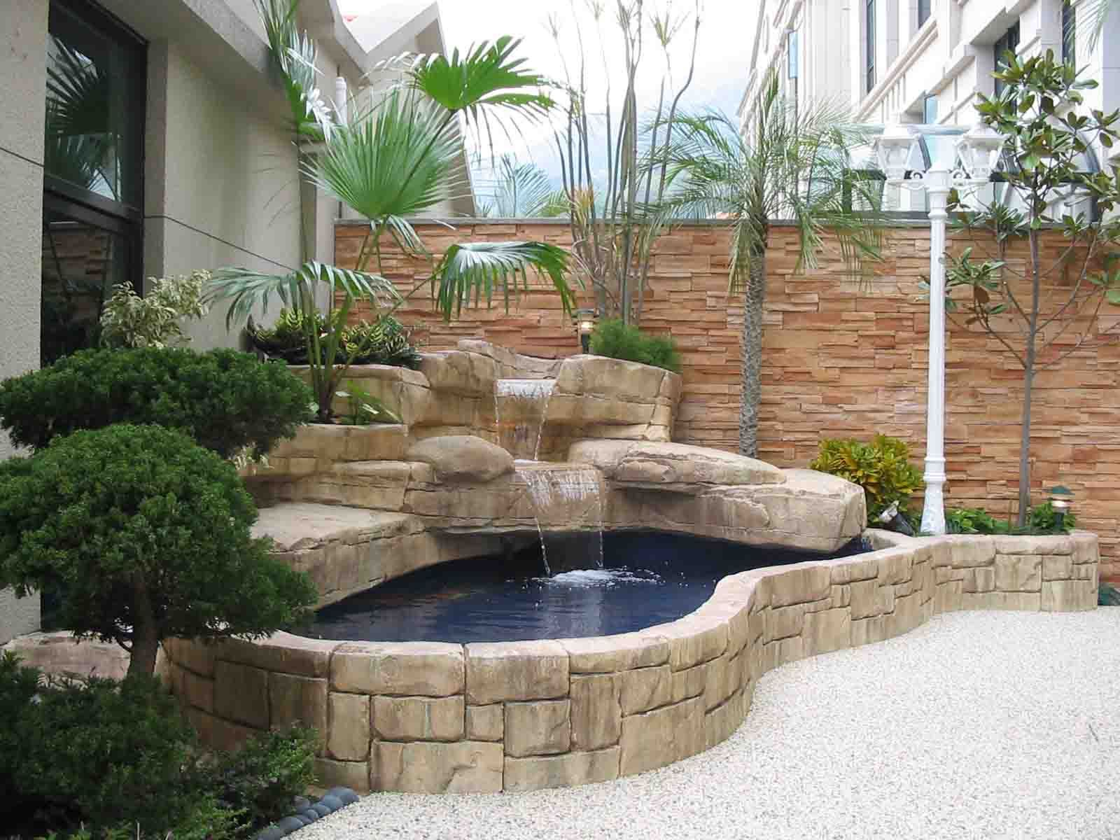 Raised pond with waterfall into inground pond google for Raised koi pond ideas