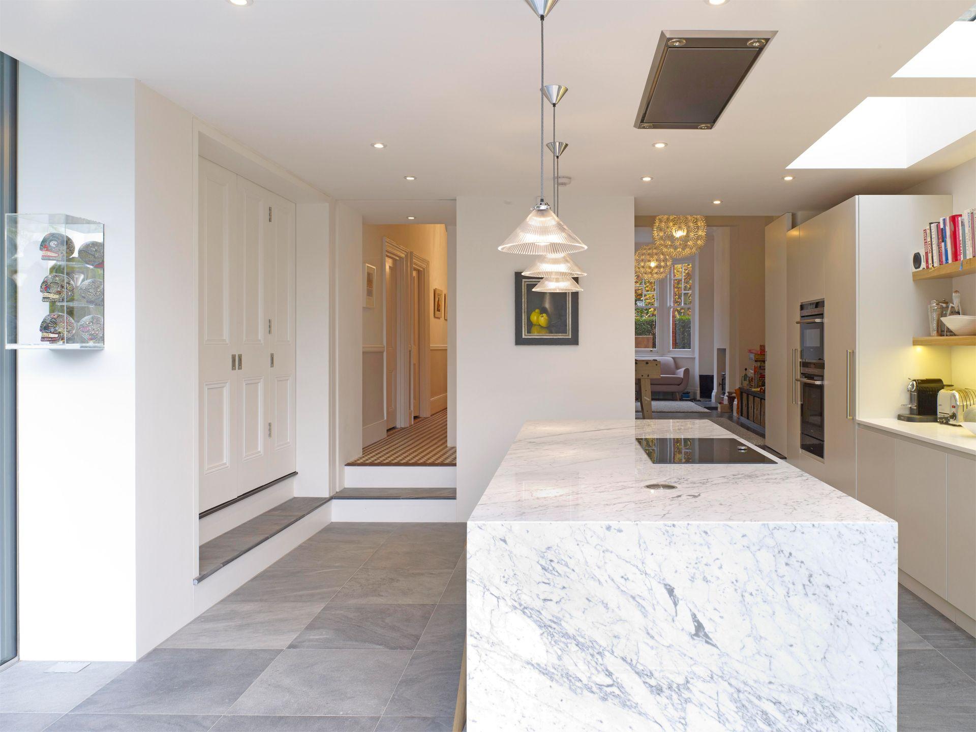 Handleless Matt Lacquer Kitchen With Oak Box Shelves, Corian Worktop And  Book Matched Carrara Marble