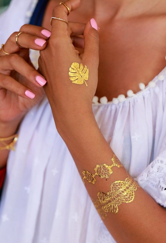 Love the new temporary tattoos in metallic shades... perfect for the beach.