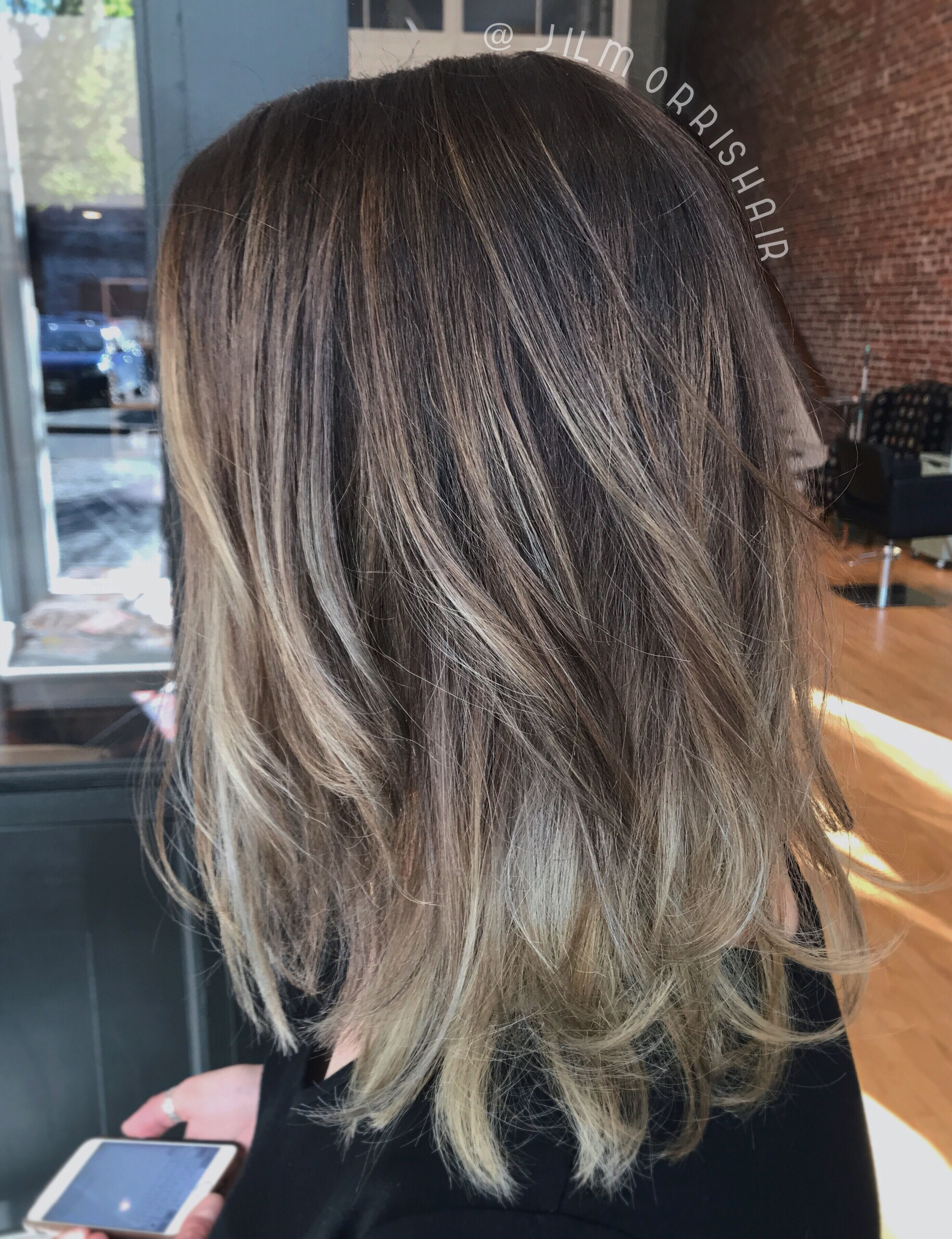 Dark ash blonde sombré balayage highlights with rooty lowlights