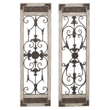 Inspired by ornate garden gates, this scrolling metal wall decor ...