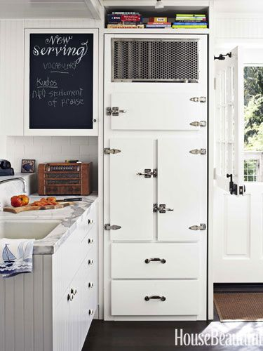 The refrigerator was made to look like an old icebox. Design: Erin Martin and Kim Dempster. Photo: Alec Hemer. housebeautiful.com. #refrigerator #vintage #kitchen #white #beach_house