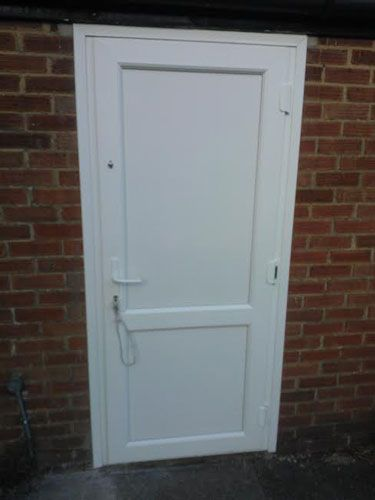 flat panel with mid rail solid upvc back door upvc back