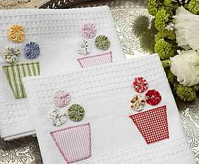 cute kitchen towels. I need to buy some yo-yo's from A to make these!