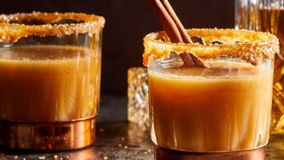 Spiced rum and caramel topping bring new life to apple cider, making this the perfect nightcap for those chilly fall evenings. #spikedapplecider