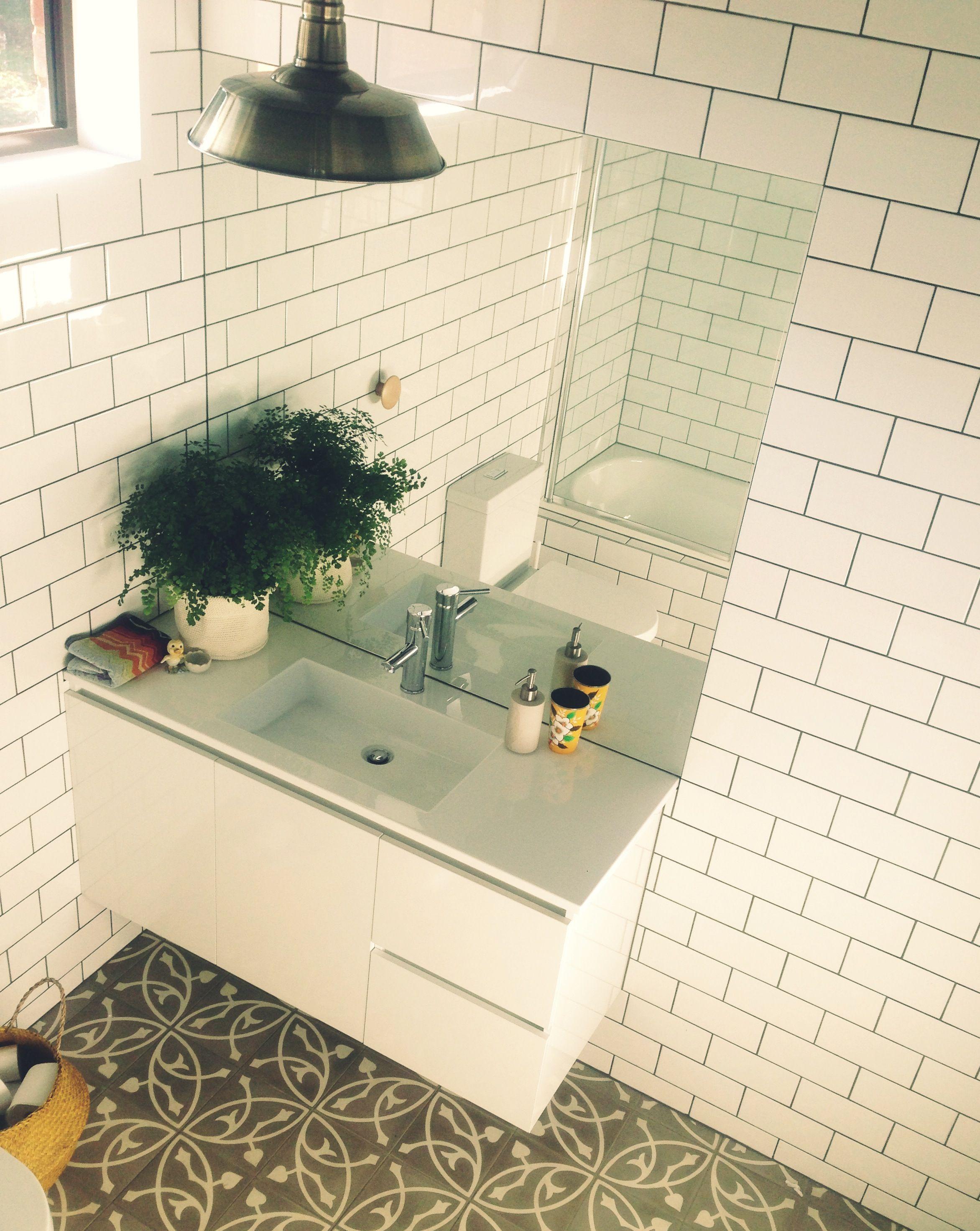 Encaustic and subway tiles beach house bathroom