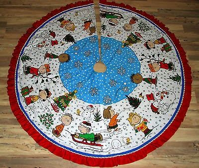 c p treasures snoopy christmas decorations to brighten your holiday check out this one of a kind handmade peanuts gang christmas tree skirt