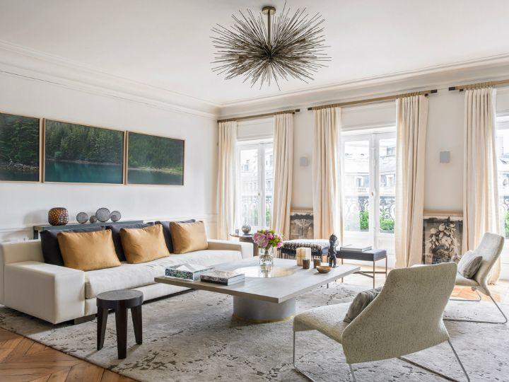 Modern French Contemporary Parisian Interiors Starburst Orbit Chandelier  And Sleek Modern Sofa