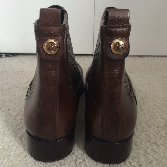 Brand New Tory Burch leather boots 100% Authentic. I purchased these as a floor model, thus the minor wear on the heel. But these have never been worn by myself, just tried on. Unfortunately too small: Tory Burch always runs small. Brand new without tags, but please keep in mind these were a floor model! Thanks, feel free to ask questions! As always, willing to email more pictures! It's a big purchase, so I TOTALLY understand wanting more pictures :) Tory Burch Shoes