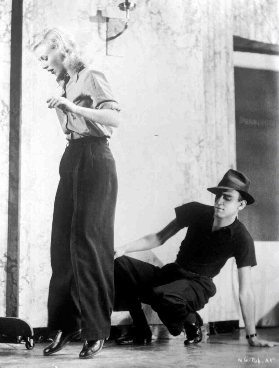 ginger rogers rehearsing with choreographer hermes pan for swing time, c. 1936