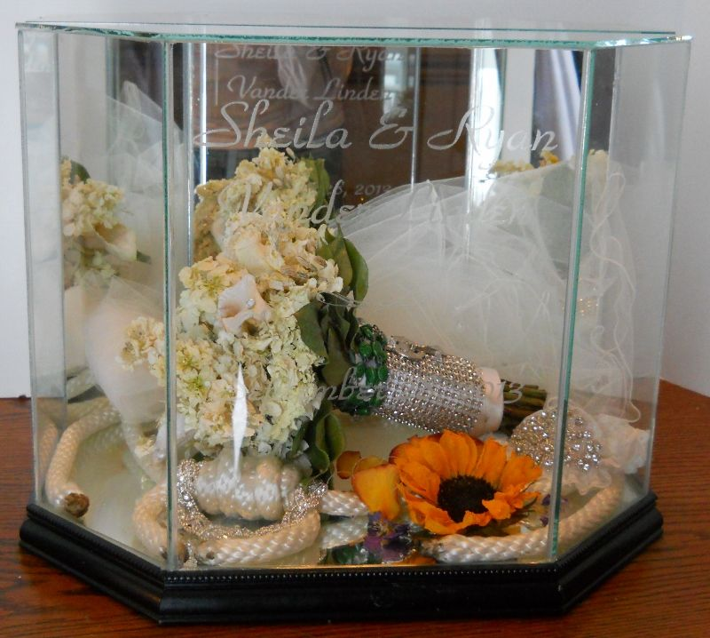 Wedding Gown Preservation Boxes: This Beautiful Glass And Mirror Display Was Provided By