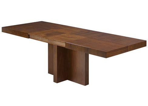 Mesa de comedor rectangular con pie central, destacando la ...