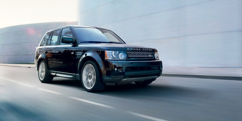 '13 Model Year Range Rover Sport – Front three quarter view on road