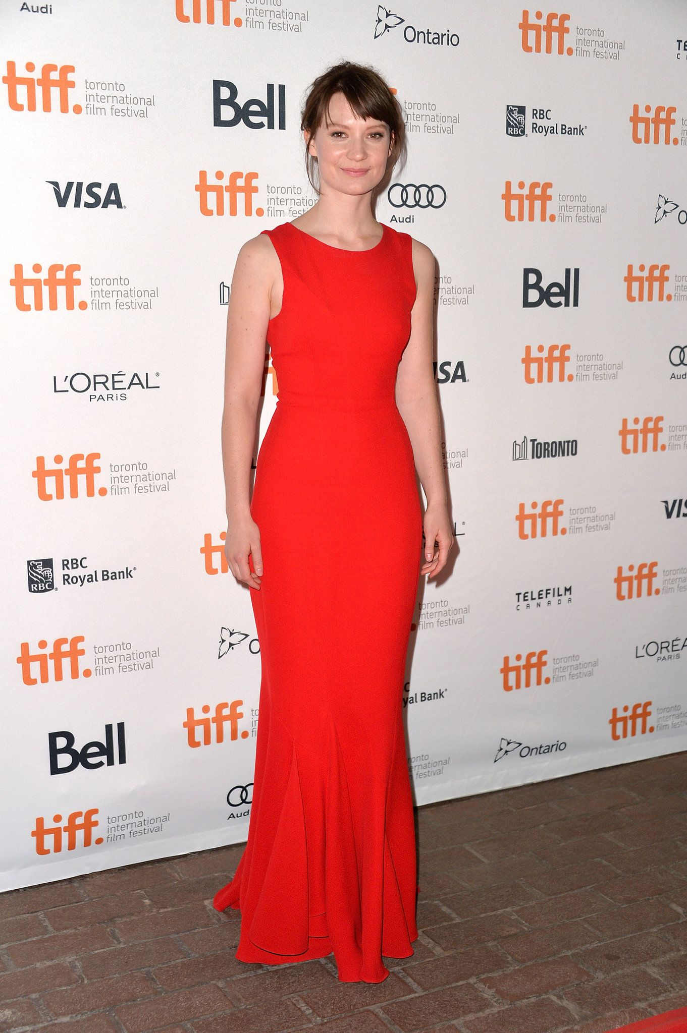 Mia Wasikowska was bright as ever in a Christian Dior red silk gown at the Only Lovers Left Alive premiere at the 2013 Toronto International Film Festival.